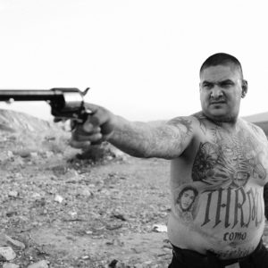 Mexican gangs characterized by tattoos and guns told by Jonathan May
