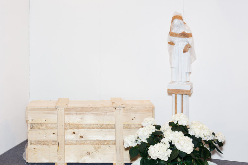 Besides Faith – Wrapped Madonna Next To A Wooden Box